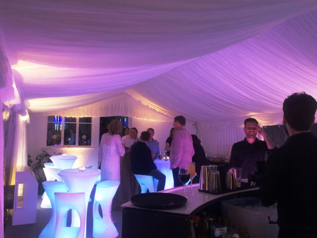 Marquee extension from clients home, with a lined roof and LED furniture