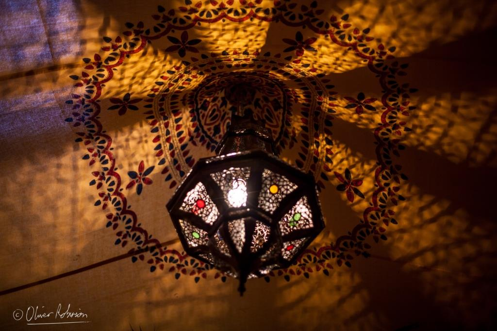 A Moroccan lantern within a party marquee