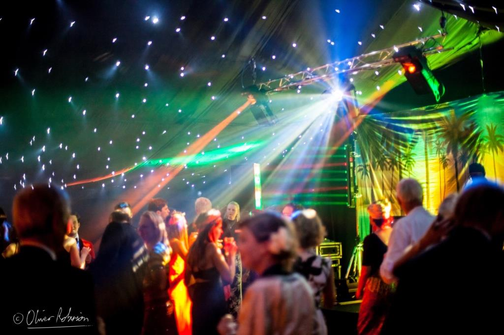 Disco lighting to get the guests moving and shaking at this marquee birthday party in the South West