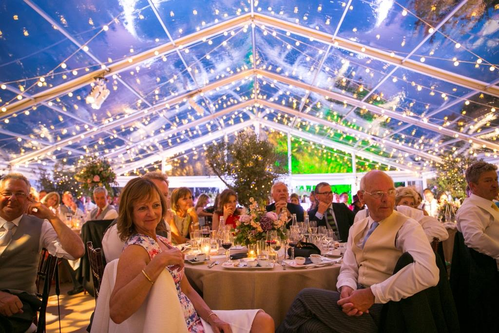 Clear roofs and festoon lights make this wedding in the South West glow