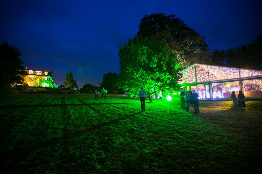 A stand out marquee with uplighters, designed by CMC