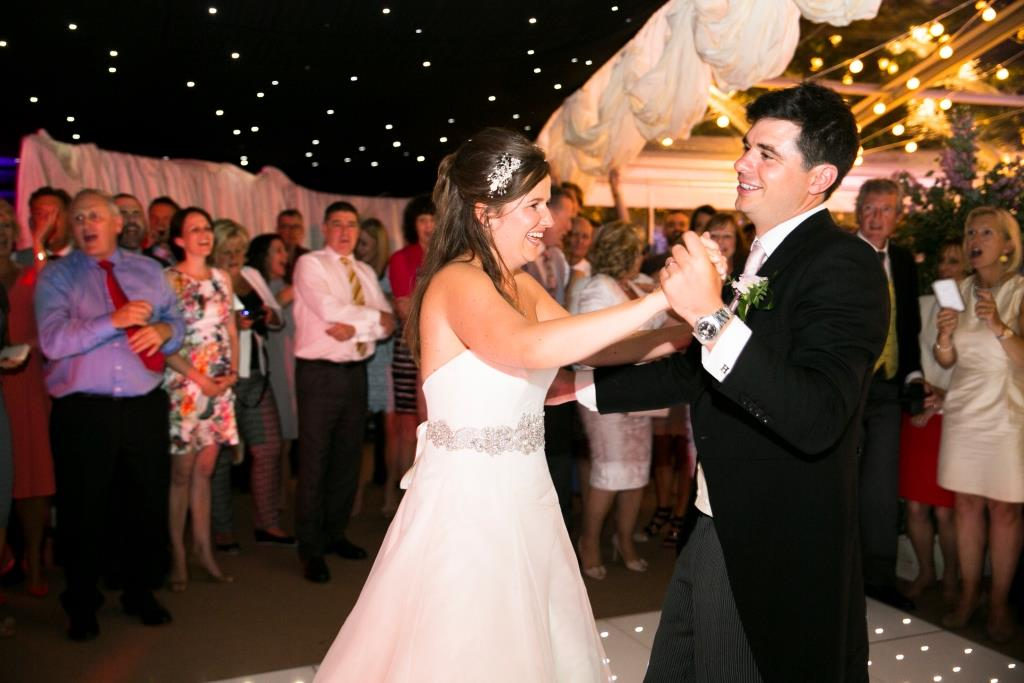 Dance beneath sparkly starlit roof linings for a romantic first dance in this marquee nightclub area