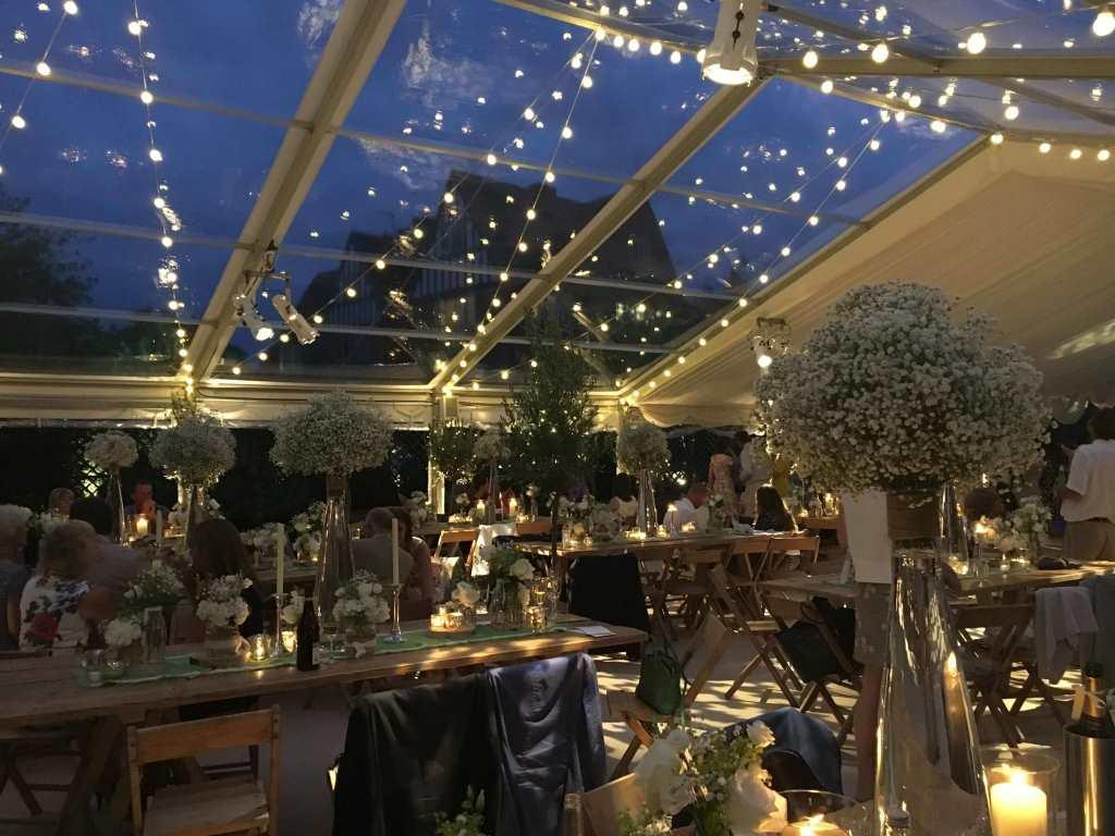 Festoon lights in the clear roofs make the marquee glow