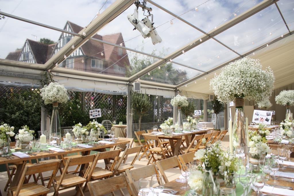 Clear roofs and panoramic window walls with vintage tables and chairs is the perfect combination