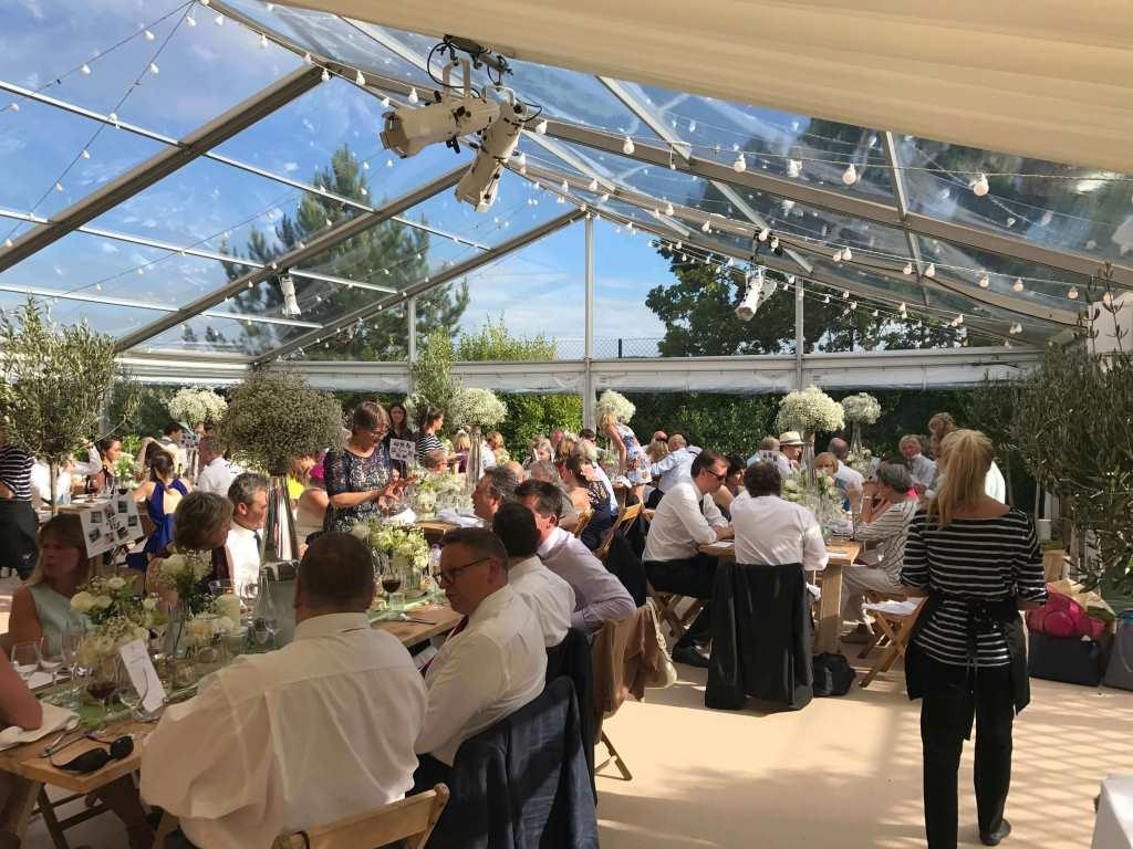 Guests dine in this beautifully decorated marquee at The Downs School, Bristol