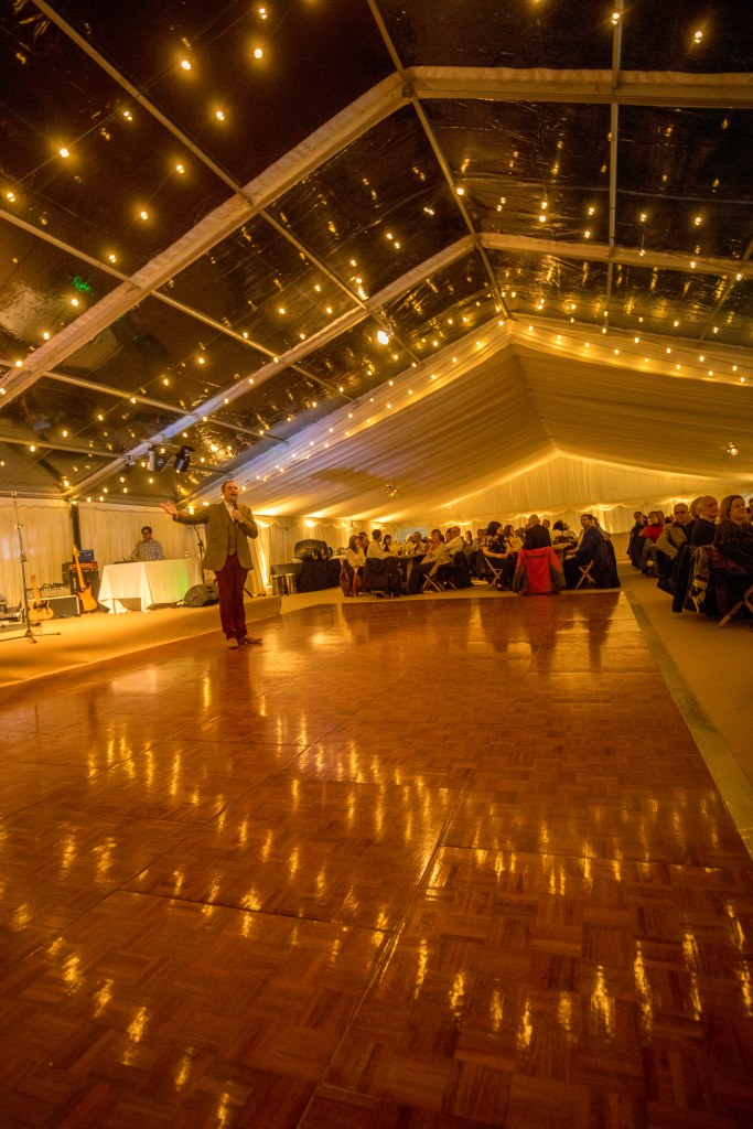 Clear roofs over a parquet dancefloor to create a focal point for performers and dancing at this marquee in the South West