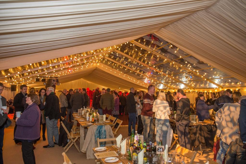 Festoon lights used to create a warm glow in this January marquee in Somerset
