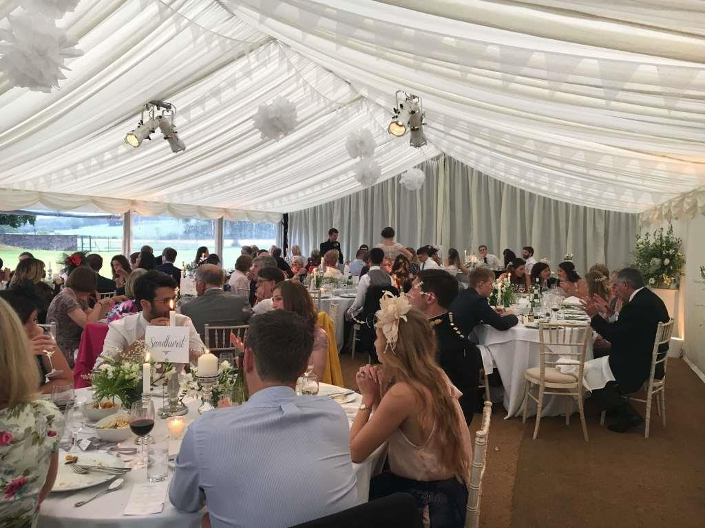 Ivory pleated linings, round tables and Chiavari chairs for this stylish wedding at The Downs School