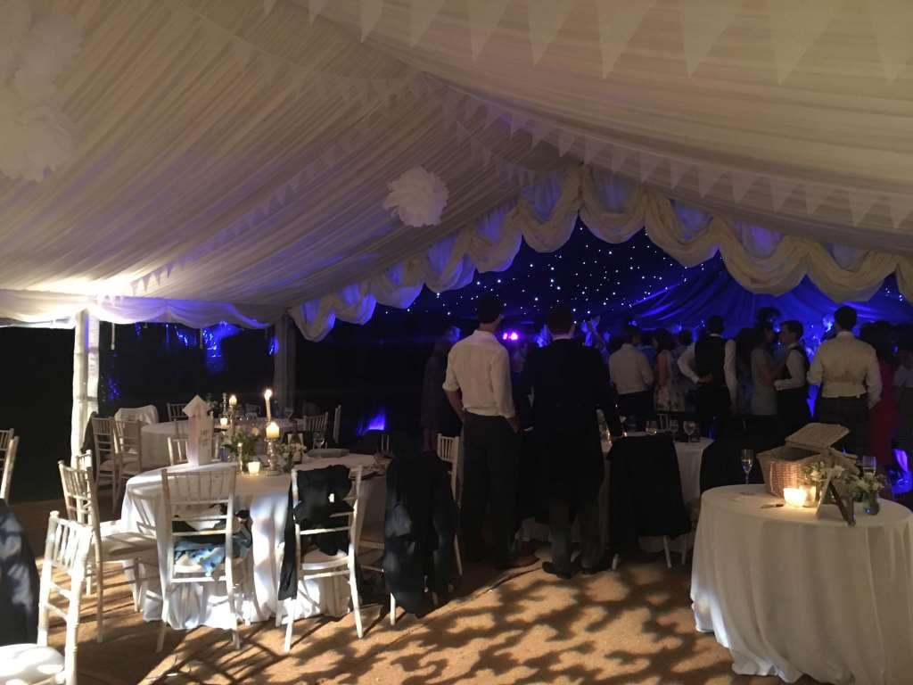Guests take to the marquee nightclub area, for a dance beneath starlight roof linings