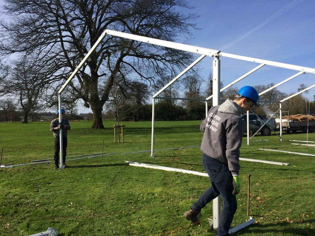 Clifton Marquee Labourers hard at work putting up a marquee for The Downs School