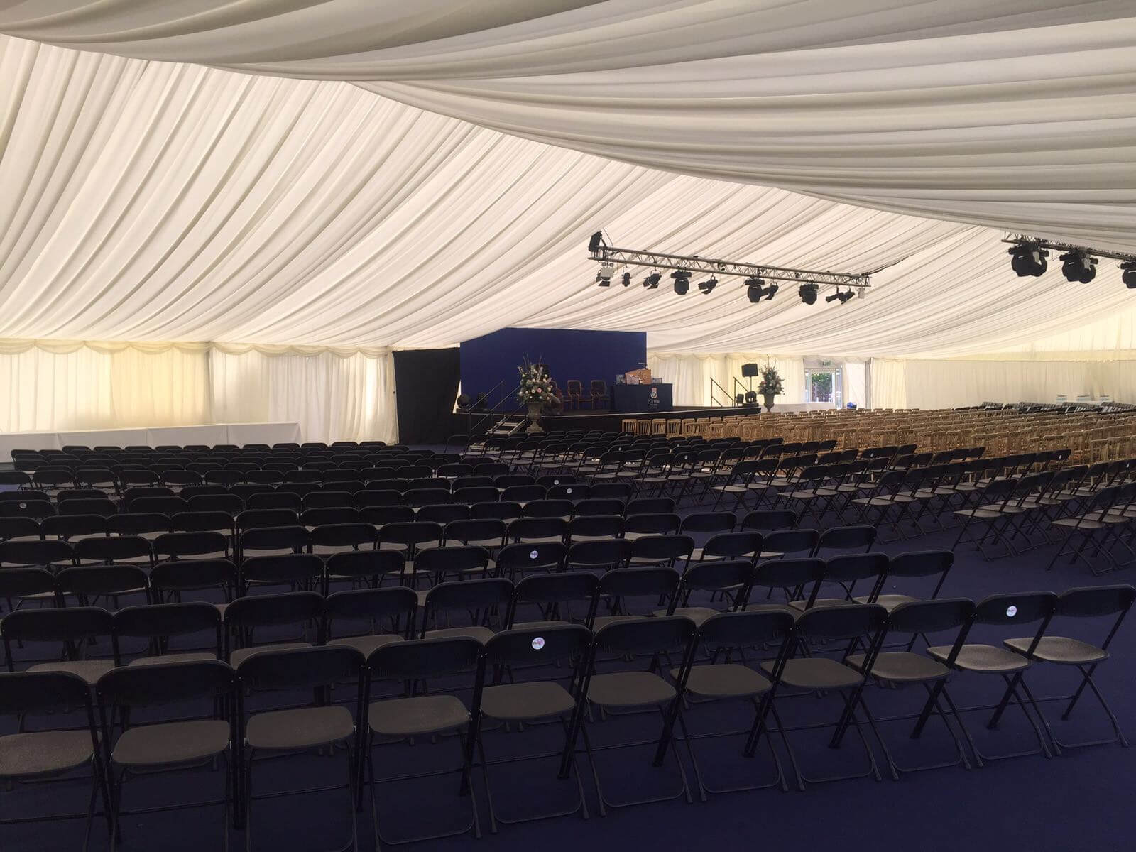 An ivory pleated lined marquee ready for guests to take their seats at the commemoration
