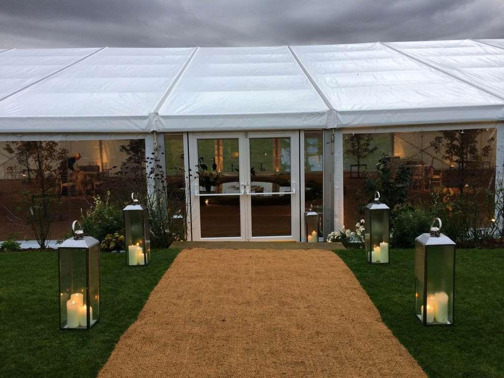Tonto lamps on either side of the marquee entrance give off a lovely glow to detract from the grey weather