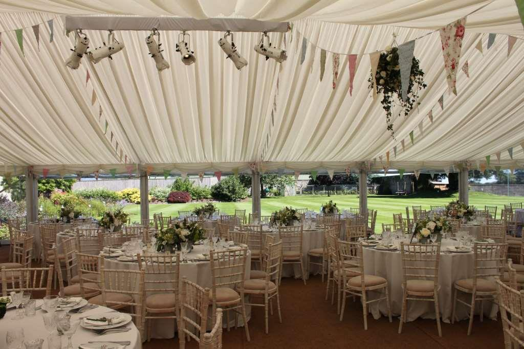 Ivory pleated roof linings and window walls at this stunning wedding at The Downs School
