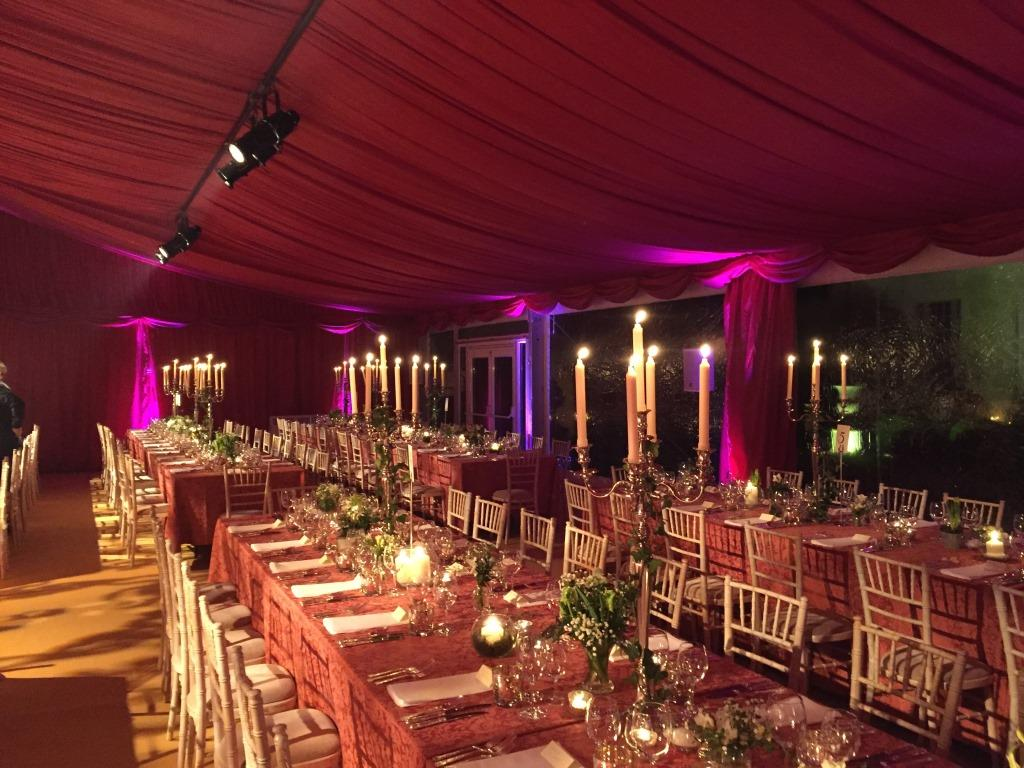 A burgundy lined marquee for a New Years Eve Wedding built by CMC