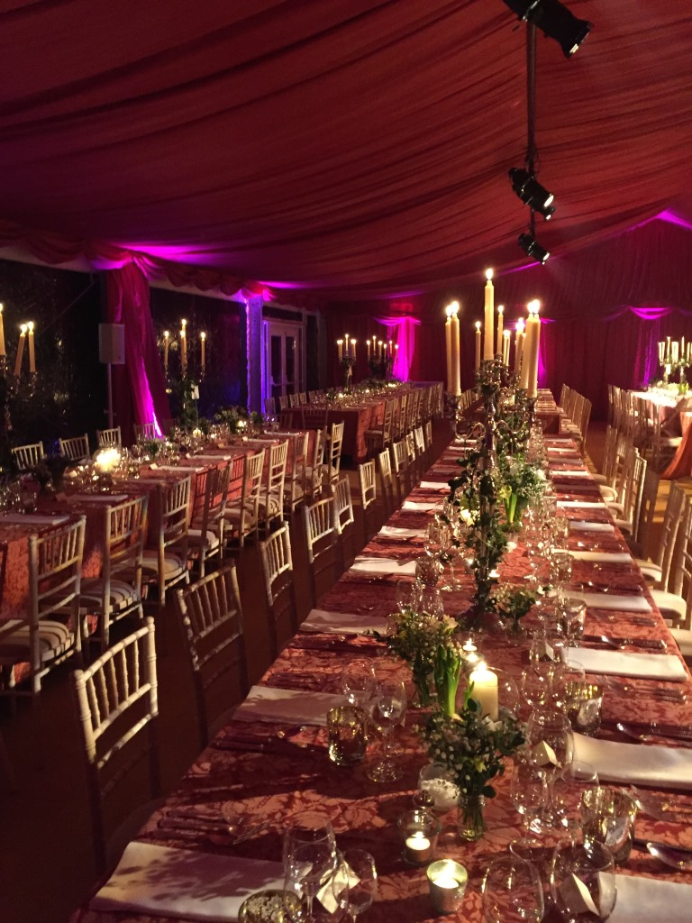 Purple uplighters to enhance the burgundy linings at this New Years Eve wedding