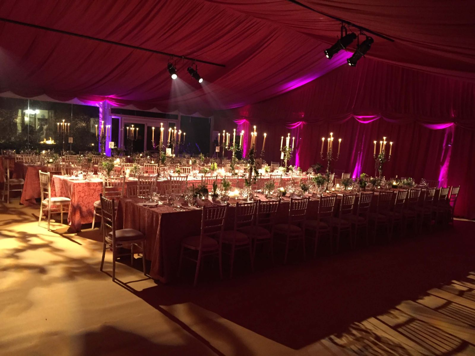 Burgundy linings, with dramatic lighting, for this New Years Eve marquee wedding