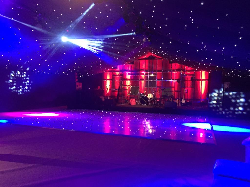 Starlight roof linings and a starlight dancefloor makes this dancing area perfect for that late night moving and grooving in this wedding marquee