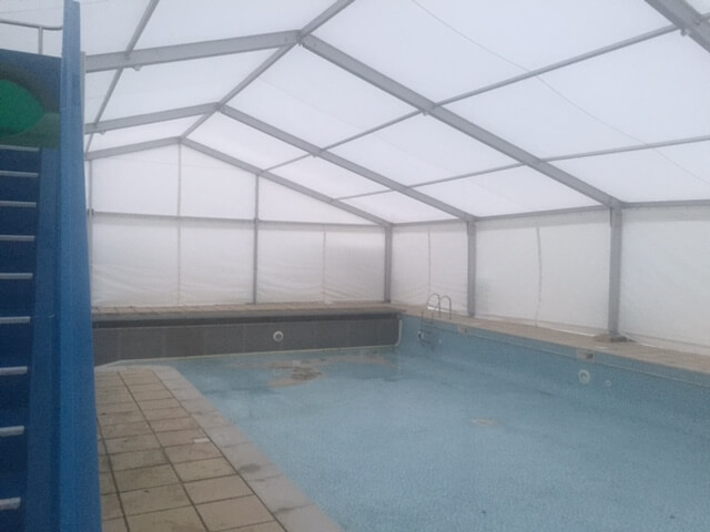 The marquee from another angle, keeping the wind off the swimming pool