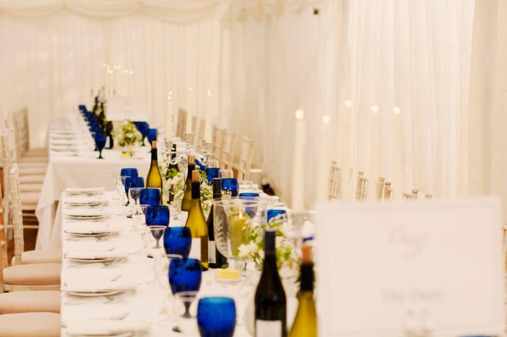 Trestle tables, chiavari chairs and ivory pleated linings look beautiful in this marquee at The Grange Belluton