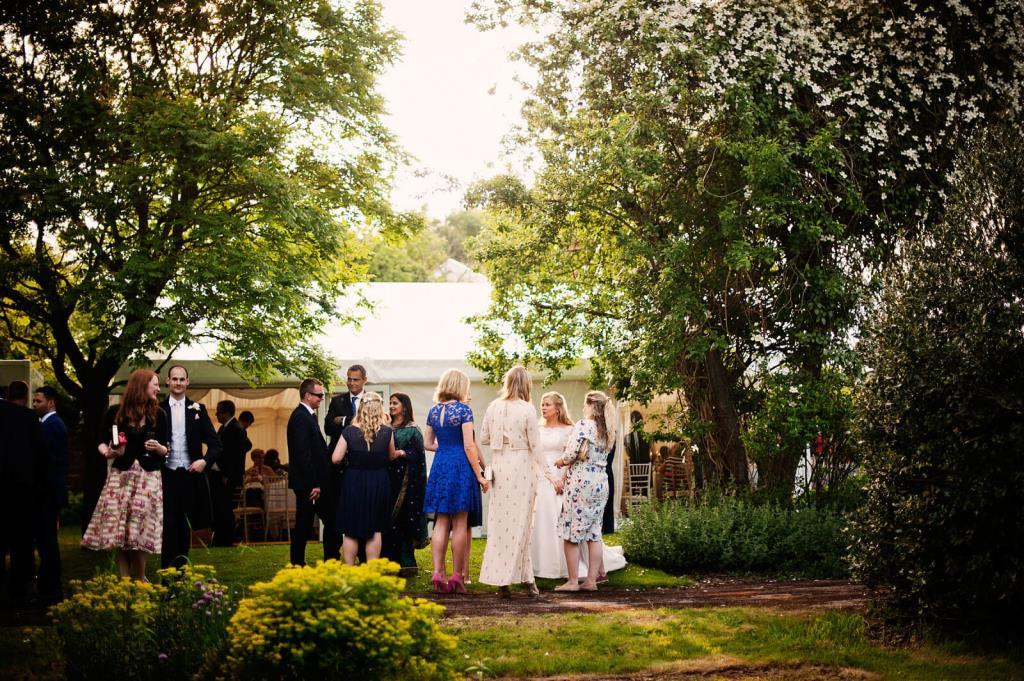 Guests chat amongst the beautiful green setting of The Grange Belluton