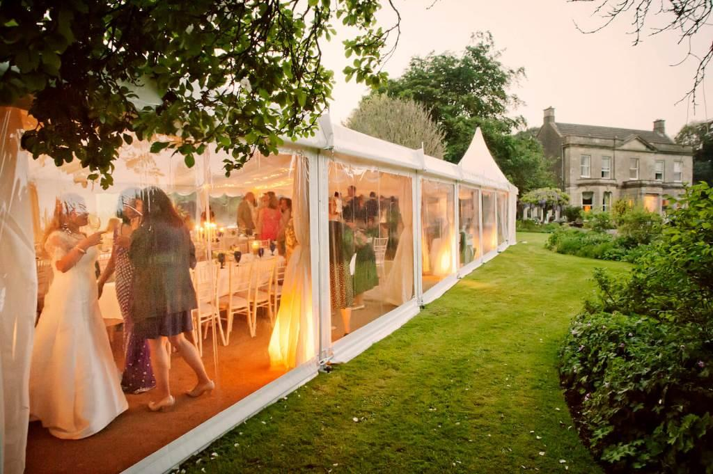 Panoramic window walls running along the side of the marquee, so guests can see their surroundings.