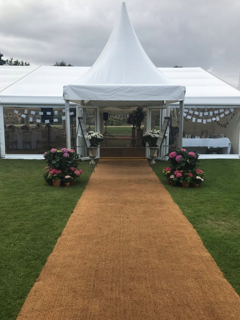 A Chinese hat entrance and a wedding marquee ready for guests to arrive, at the Mansion House, Bristol