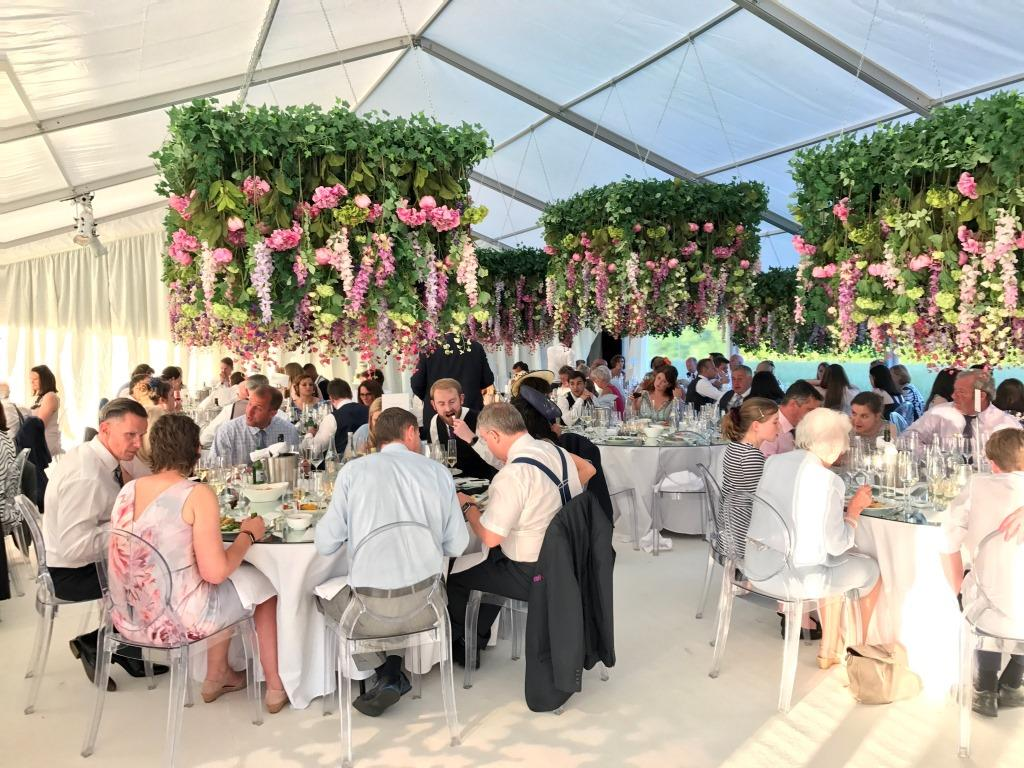 The sun lights this wedding marquee, and window walls are rolled up so the can breeze flow through