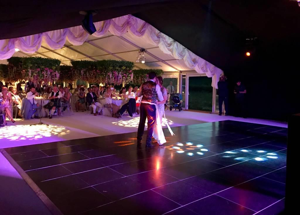 The happy couple take center stage and enjoy their first romantic dance together in this stylish nightclub area
