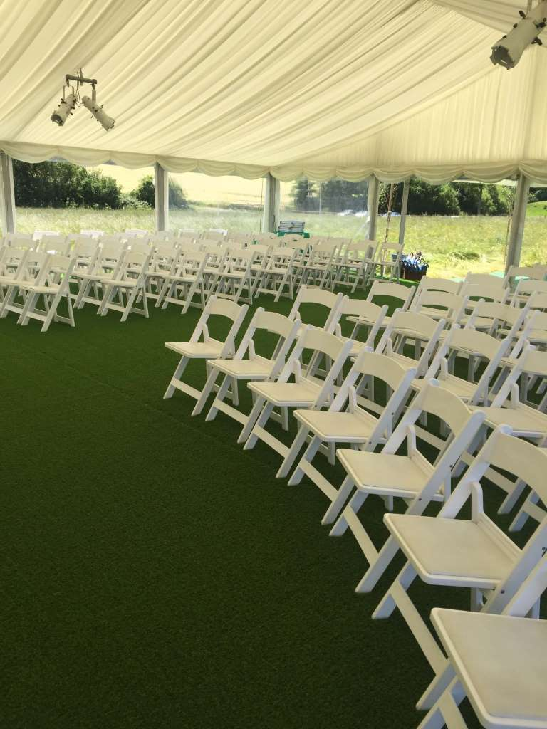 Marquee blessing area with ivory pleated roof linings and panoramic window walls