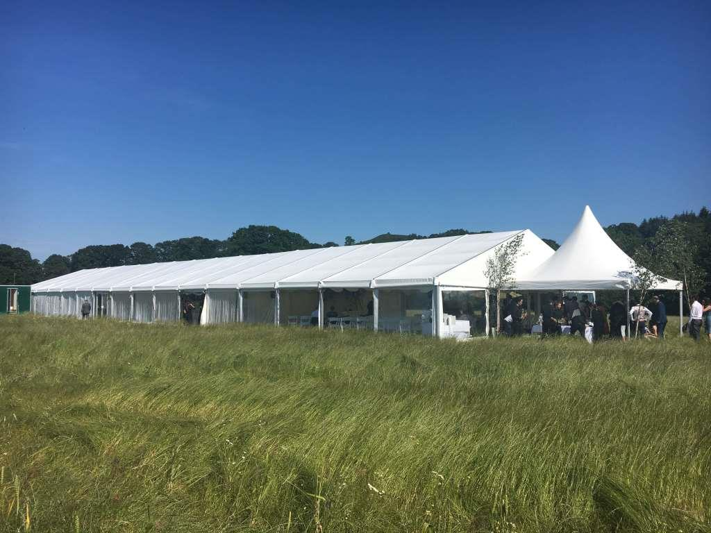 Wedding Marquee laid out in the sun, ready for guests to arrive
