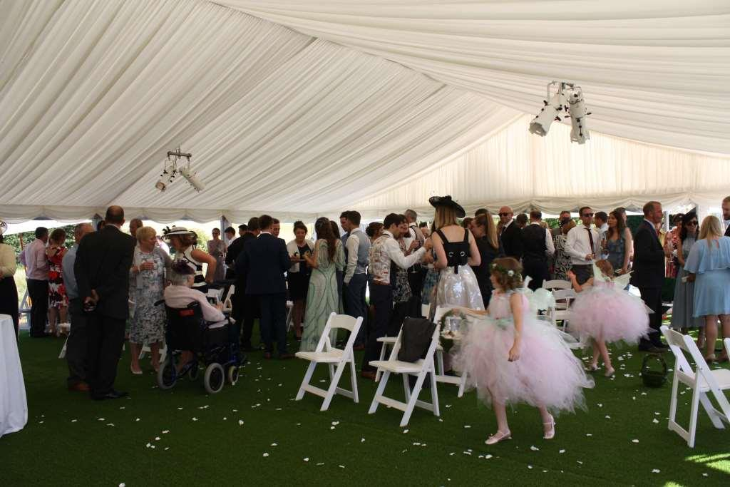 Guests celebrate the newlyweds in this gorgeous marquee blessing area, at this Bristol based wedding