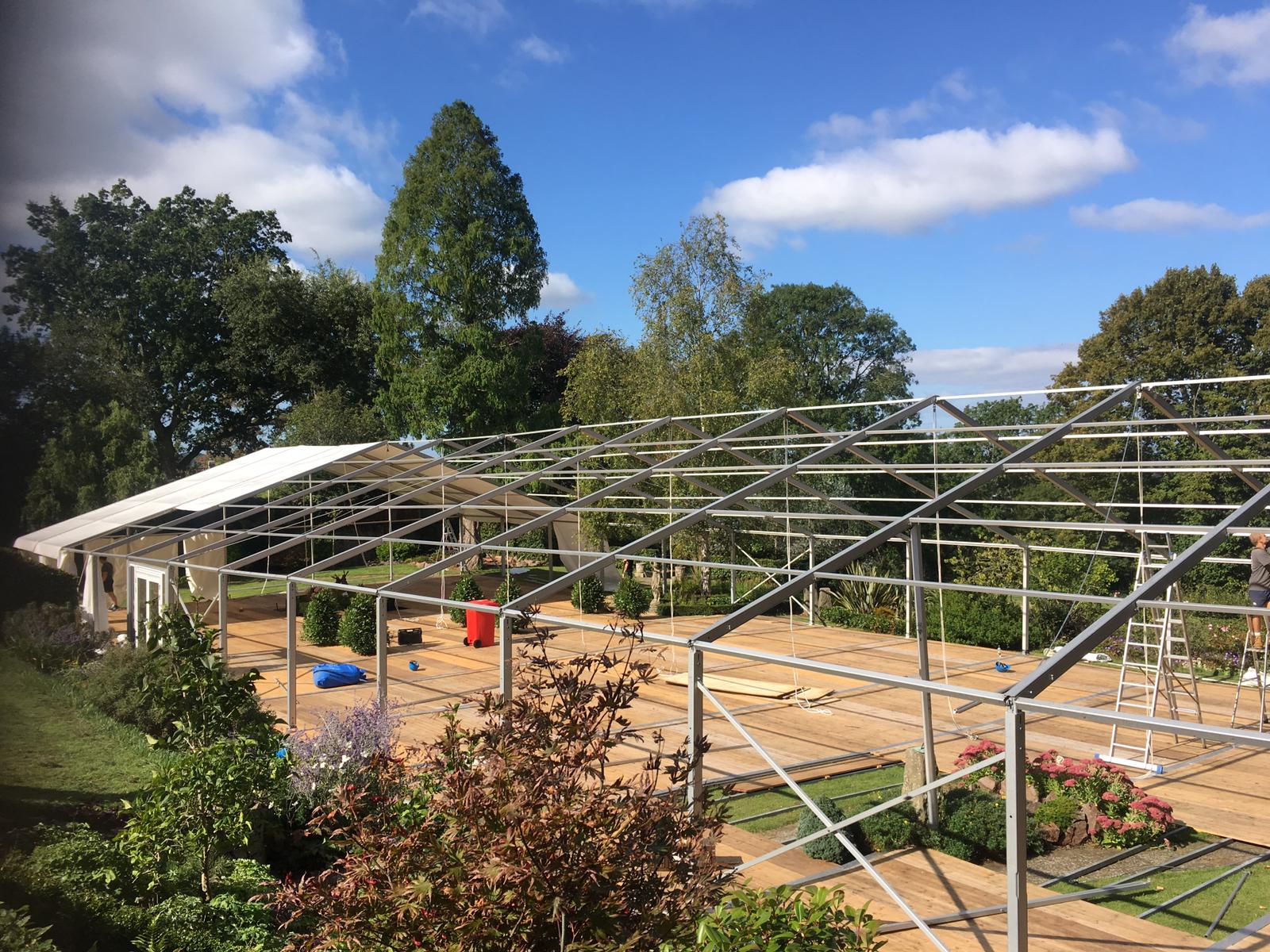 Marquee Size Guide - Marquee in garden at home, working around borders and garden furniture