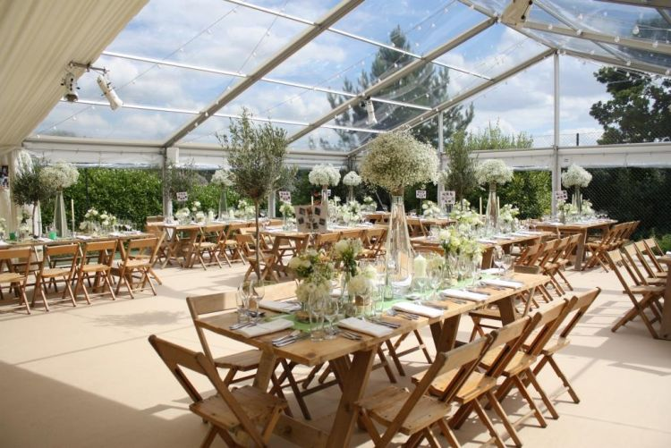 Marquee on a tennis court with clear roofs and panoramic window walls at a client's home in Bristol